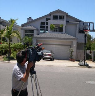 KUSI Channel 9/51 News cameraman photographing Duke Cunningham's old Del Mar Home